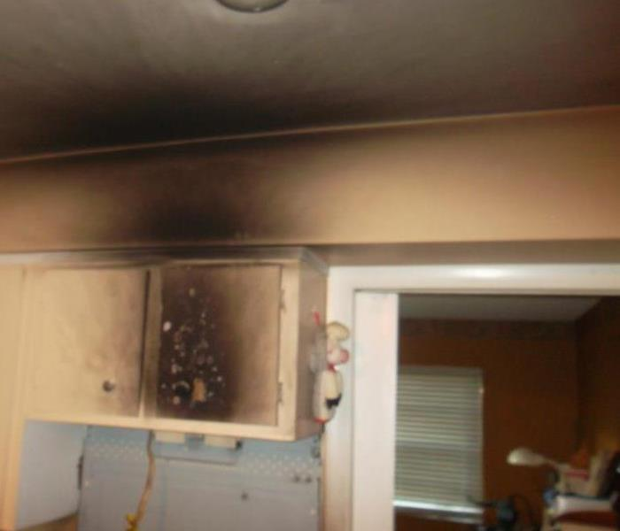 Smoke Damage to a Longwood home Kitchen Before