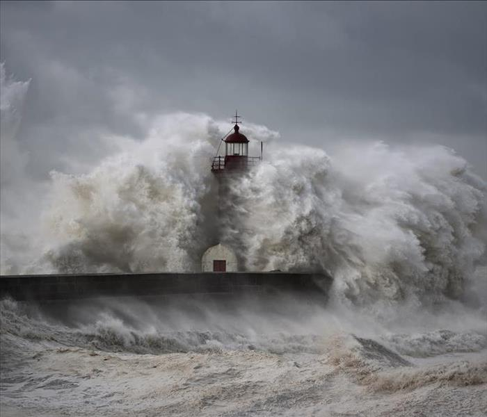 massive waves over lighthouse
